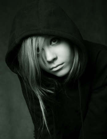 Portrait of the young girl in a black hood photo