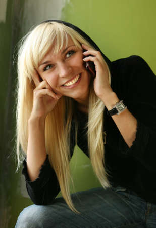 Pretty smiling blonde with the phone photo