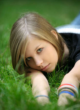The girl in a grass. The face close-up Stock Photo - 1335909