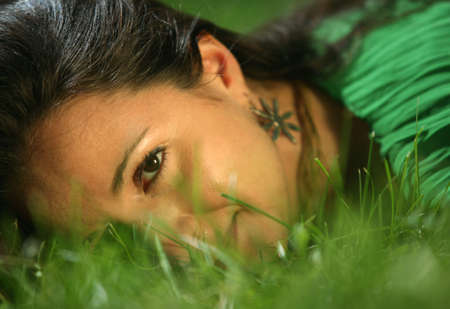 The girl in a grass. The face close-up Stock Photo - 1335912