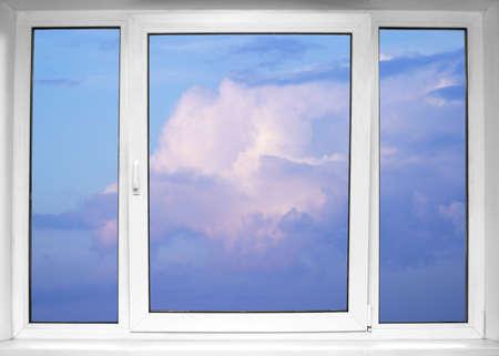 white window: Sky seen through an white window Stock Photo