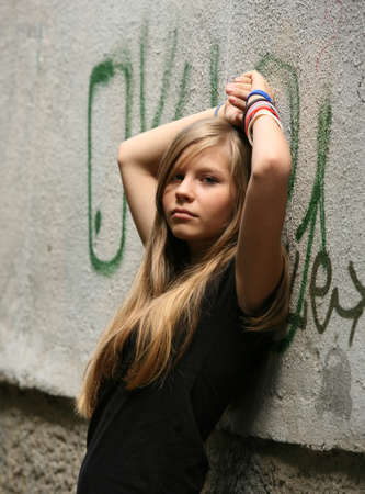 The girl - teenager on a background of a wall Stock Photo - 1438788