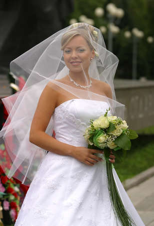 debutante: Portrait of the beautiful bride in veil with a bouquet Stock Photo