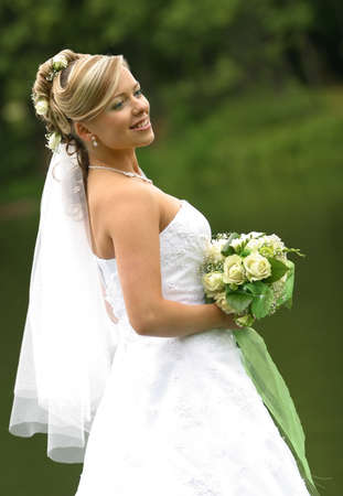 fiance: Portrait of the beautiful bride with a bouquet