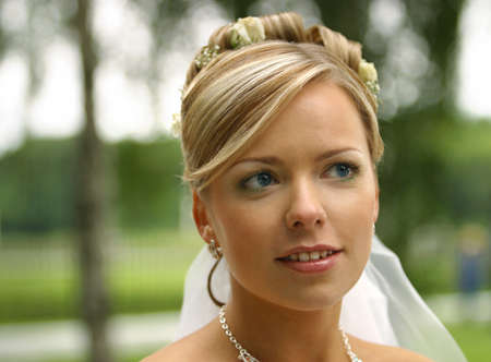 The beautiful bride on a green background Stock Photo - 1598393