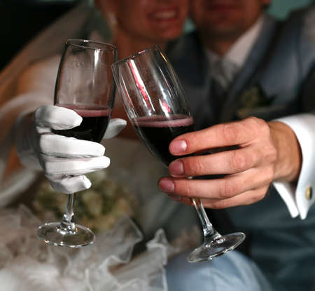 Glasses of champagne in a hands of the groom and bride photo