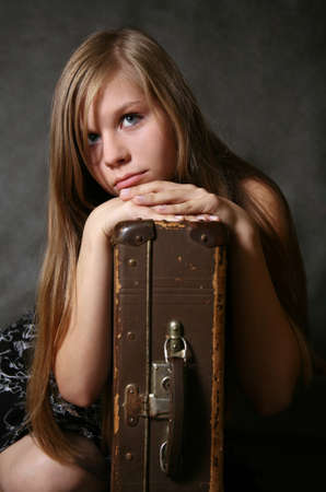 Portrait of the young girl with a suitcase Stock Photo - 1677822