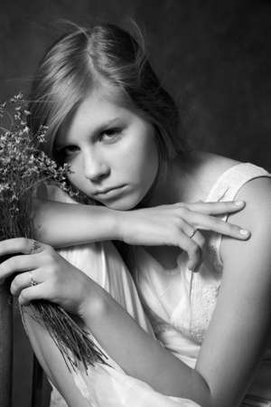 The sad girl with a bouquet from field flowers Stock Photo - 1677833