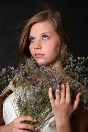 The girl with a bouquet from field flowers Stock Photo - 1677835