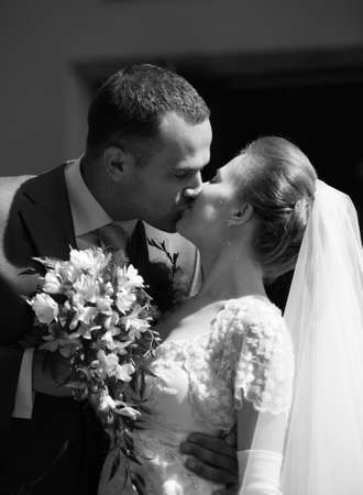 debutante: Beautiful the bride and the groom kiss Stock Photo