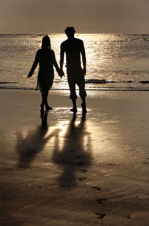 Couple on sunset. Coast of the Indian ocean Stock Photo - 2028908