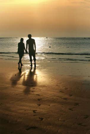 Couple on sunset. Coast of the Indian ocean Stock Photo - 2028907