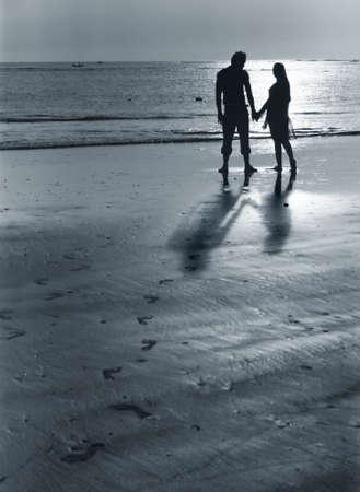 Couple on sunset. Coast of the Indian ocean Stock Photo - 2036851