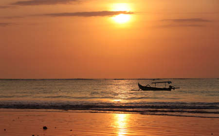 Drifting boat on a sunset. Coast of the Indian ocean. Bali Stock Photo - 2056958