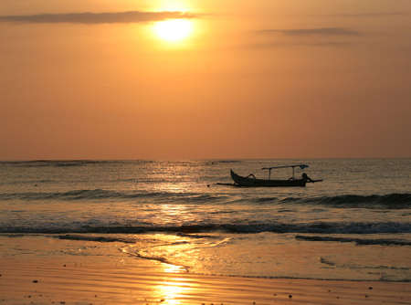Drifting boat on a sunset. Coast of the Indian ocean. Bali Stock Photo - 2056963