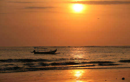 hobie: Drifting boat on a sunset. Coast of the Indian ocean. Bali Stock Photo