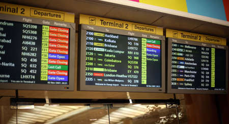 time flies: a flight announcement shows time of departure on a screen