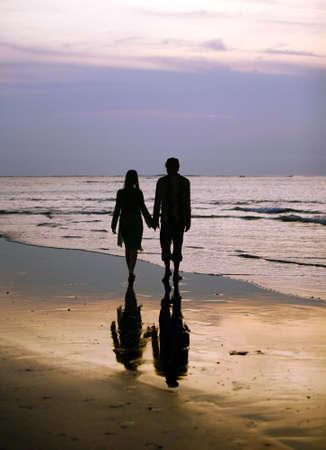 Couple on sunset. Coast of the Indian ocean Stock Photo - 2096838