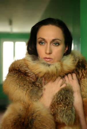 The beautiful woman in a collar from the fox fur