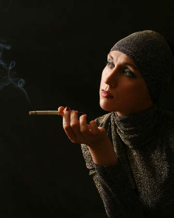 Lady with a cigarette on black background photo