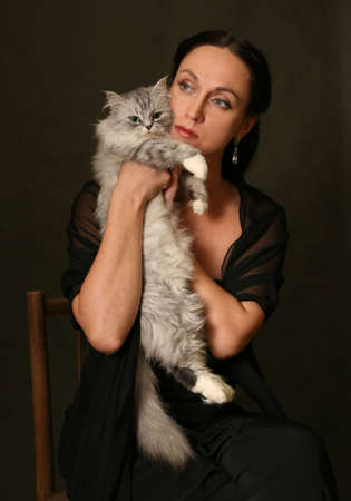 puckered: Beautiful woman with silver cat in studio Stock Photo