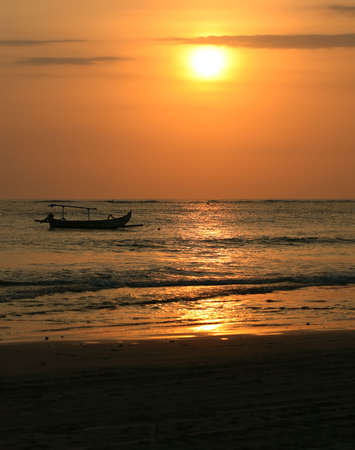 Drifting boat on a sunset. Coast of the Indian ocean. Bali Stock Photo - 2150682