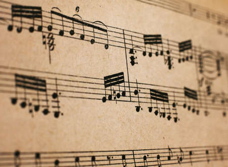 antiquarian: Old vintage musical page close-up Stock Photo