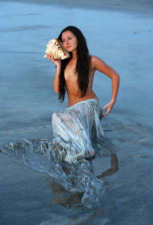 adult mermaid: The beautiful girl in a role of the mermaid