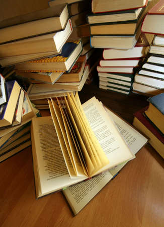 bibliomania: Many old books combined by a heap Stock Photo