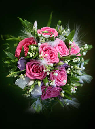 Wedding bouquet from roses on a green background Standard-Bild