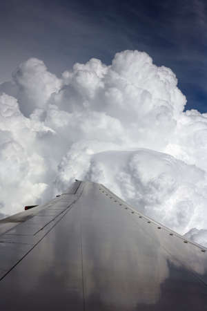 soft hail: Wing of the plane on a background of clouds