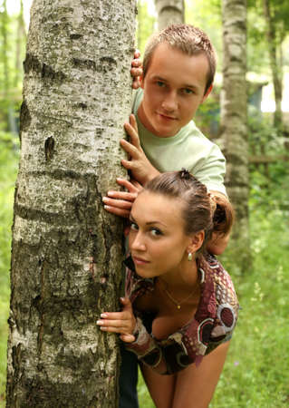 Young girl and the man in a forest Stock Photo - 2407802