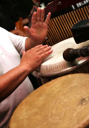 nigerian: Man playing the djembe (nigerian drum)