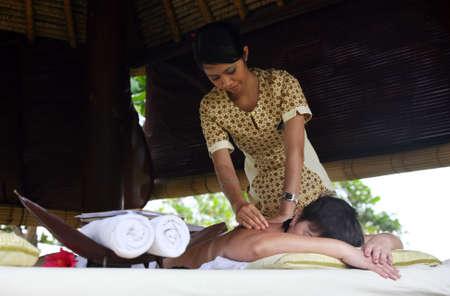 bali massage: White woman on massage in Bali salon Stock Photo