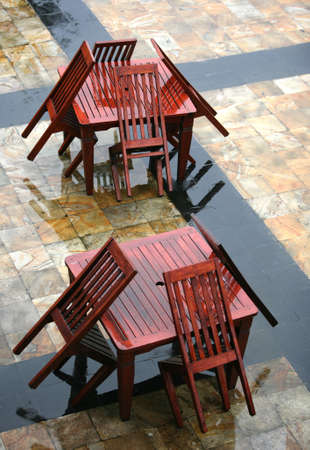 drenched: Table and chairs wet from a rain