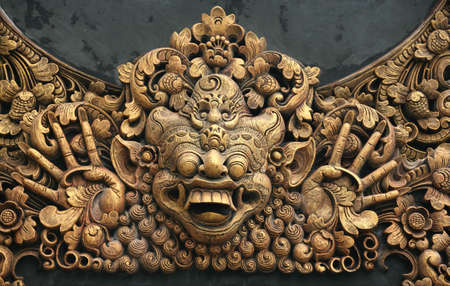 hundreds: Hundreds years old carving at Pura in Bali, Indonesia Stock Photo