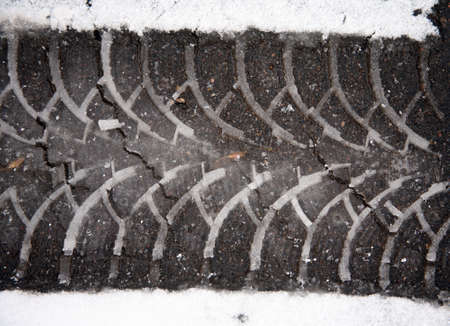 marking up: Print auto tire on asphalt on wet snow Stock Photo