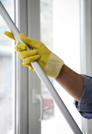 The cleaner washes a window