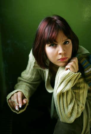 The beautiful brunette gets a light a cigarette photo