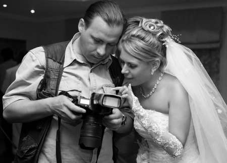 The beautiful bride and the photographer