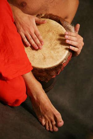 Man playing the nigerian drum in studio Stock Photo - 2812685
