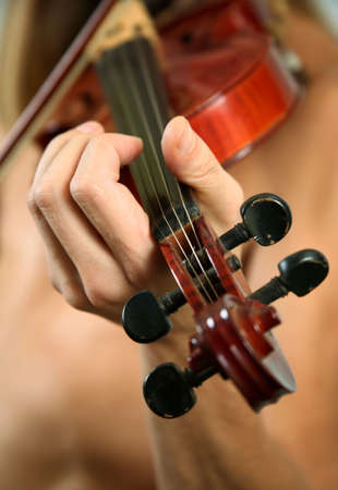 concerto: Musician playing violin close-up in studio