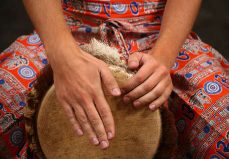 Man playing the djembe (nigerian drum) in studio Stock Photo - 2812688