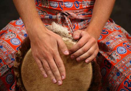 rhythm rhythmic: Man playing the djembe (nigerian drum) in studio