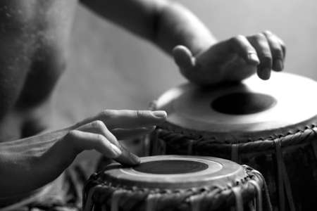 vibrations: Man playing the djembe (nigerian drum) in studio
