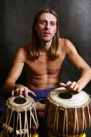 Man playing the nigerian drum in studio Stock Photo - 2812435