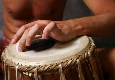 nigerian: Man playing the djembe (nigerian drum) in studio