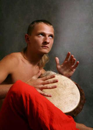 Man playing the nigerian drum in studio photo