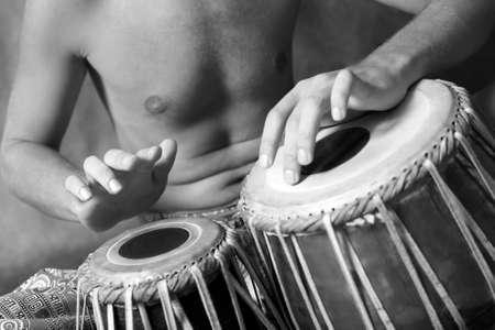 nigerian: Man playing the nigerian drum in studio