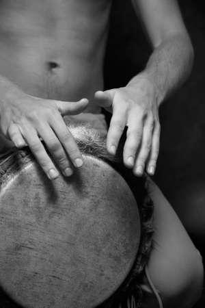 Man playing the djembe (nigerian drum) in studio Stock Photo - 2819336